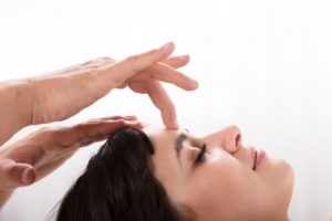 woman receiving reflexology for cold