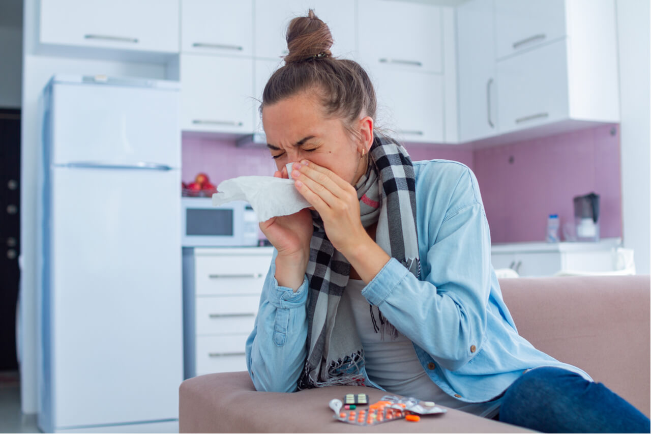 woman sneezing with cold